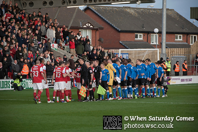 Fleetwood Town 1 Wrexham 1, 10/04/2012. Highbury Stadium, Football Conference Premier. The two teams exchanging handshakes before Fleetwood Town (in red) hosted Wrexham in a Blue Square Conference Premier match at Highbury Stadium. The match, between the top two teams in the division ended in a 1-1 draw watched by a near-capacity crowd of 4996. A victory for the hosts would have seen the club promoted to the Football League for the first time. Photo by Colin McPherson.