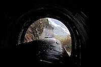 The Alaska Railroad's Coastal Classic train enters a tunnel as it heads into the rugged Chugach Mountains.