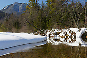 Swift River in Albany, New Hampshire during the winter months. This river travels along side of the Kancamagus Scenic Byway, which is one of New England's scenic byways. Mount Passaconaway is off in the distance.