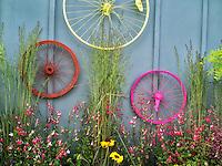 Bicycle rims garden display. Al's Nursery. Sherwood, Oregon