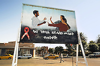 Eritrea. Maekel province. Asmara. A black man walks on the road. Yellow taxis on the street. HIV Aids billboard. Red ribbon. The campaign says: Take care of those friends who don't think of tomorrow. © 2006 Didier Ruef