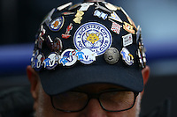 A Leicester City fan with badges on his hat during the Barclays Premier League match between Leicester City and Swansea City played at The King Power Stadium, Leicester on 24th April 2016