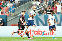 DENVER, CO - JUNE 6: John Brooks #6 of the United States wins the header during a game between Mexico and USMNT at Mile High on June 6, 2021 in Denver, Colorado.