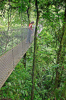 A visitor (mr) on a hanging bridge on Arenal Hanging Bridges Trail, Arenal, Costa Rica