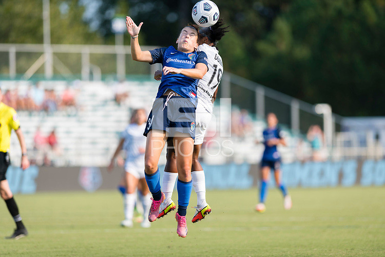 CARY, NC - SEPTEMBER 12: Angharad James #34 of the NC Courage and Crystal  Dunn #19 of the Portland Thorns challenge for the ball in the air during a game between Portland Thorns FC and North Carolina Courage at WakeMed Soccer Park on September 12, 2021 in Cary, North Carolina.