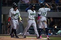 Travis Demeritte (12) of the Gwinnett Stripers celebrates with teammate Johan Camargo (17) after hitting a grand slam against the Charlotte Knights at Truist Field on July 17, 2021 in Charlotte, North Carolina. (Brian Westerholt/Four Seam Images)