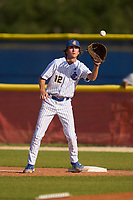 John Carroll Rams first baseman Cooper Grimes (12) stretches for a throw during a High School game against the Frostproof Bulldogs on April 27, 2021 at Lawnwood Stadium in Fort Pierce, Florida.  (Mike Janes/Four Seam Images)