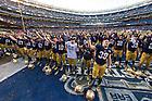 Dec. 28, 2013; The Irish sing the Alma Mater after winning the Pinstripe Bowl in Yankee Stadium.<br /> <br /> Photo by Matt Cashore