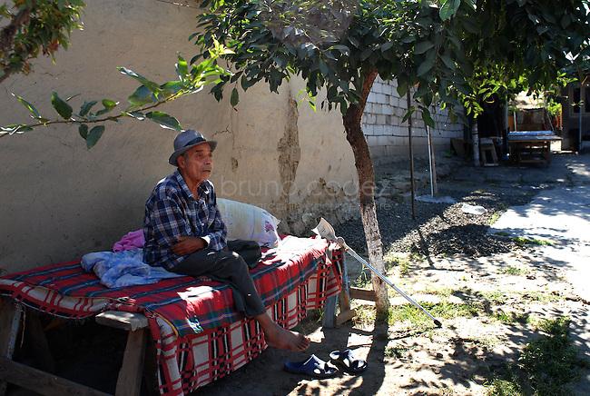 """ROMANIA, Tulcea, Viitorului Street, 2010/08/24.Half of the Roma families living in the district of Tulcea Viitorului, bordering the former industrial conglomerate, lives in France. This area is one of the poorest in the city without running water and sometimes no electricity. The street of """"future"""" is always paved. The families live mainly social benefits and hope all from one day to join Roma in Saint-Denis France)..© Bruno Cogez..Roumanie, Tulcea, quartier de Viitorului, 24/08/2010.La moitié des familles roms vivant dans le quartier Viitorului de Tulcea, en bordure de 'lancien combinat industriel, vit en France. Ce quartier est un des plus pauvre de la ville, sans eau courante et parfois sans électricité. Les familles vivent principalement des allocations sociales et espèrent toutes partir un jour rejoindre les Roms de Saint-Denis..© Bruno Cogez"""
