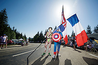 'Superheroes' Borat & Captain America there to buzz some power over to the riders up the final climb to Chamrousse <br /> <br /> 2014 Tour de France<br /> stage 13: Saint-Etiènne - Chamrousse (197km)