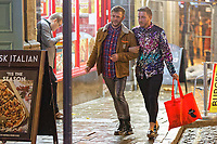 Pictured: Two men walk in Wind Street, Swansea, south Wales, UK. Friday 21 December 2018<br /> Re: Black Eye Friday, also known as Mad Friday or Black Friday which is the last Friday before Christmas Day.