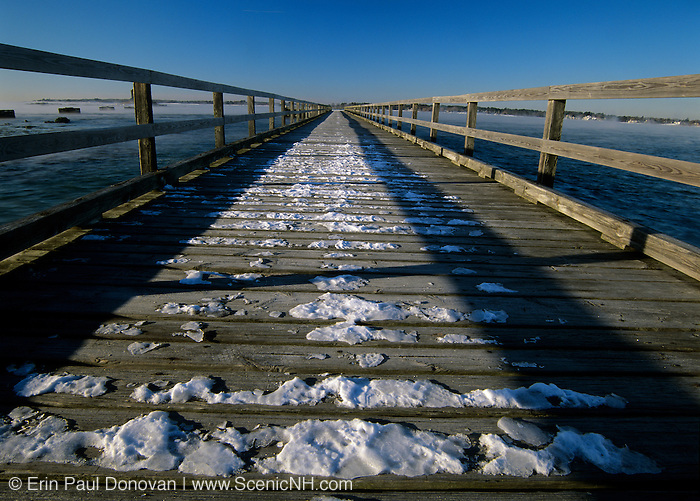 Long wooden wharf / pier at Fort Foster. Located in Kittery, Maine USA, in Portsmouth Harbor, which is part of the New England seacoast.