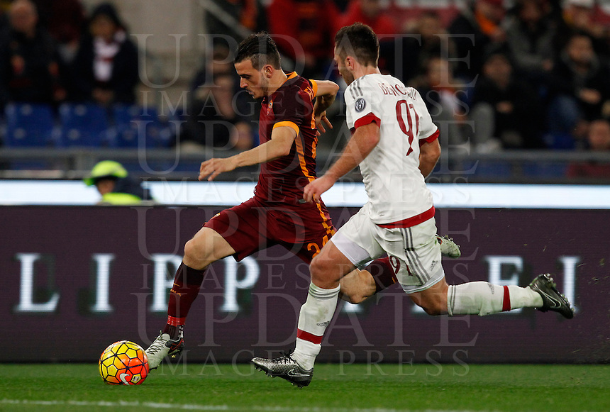 Calcio, Serie A: Roma vs Milan. Roma, stadio Olimpico, 9 gennaio 2016.<br /> Roma's Alessandro Florenzi, left, is challenged by AC Milan's Andrea Bertolacci during the Italian Serie A football match between Roma and Milan at Rome's Olympic stadium, 9 January 2016.<br /> UPDATE IMAGES PRESS/Riccardo De Luca