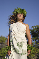 Female (wahine) hula dancer deep in thought, wearing palapalai fern head lei.