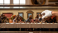 BNPS.co.uk (01202 558833)<br /> Pic: ZacharyCulpin/BNPS<br /> <br /> Last Supper <br /> <br /> Pictured: Auctioneer, Jack Young with the Last Supper carved limewood tableau.<br /> <br /> A miniature replica of Da Vinci's Last Supper depicting the iconic biblical scene in precise detail has emerged for sale.<br /> <br /> The strikingly beautiful tableau, measuring 37in long by 12in high, was carved by little-known German sculptor, Hans Mayr, in 1872.<br /> <br /> It shows an angelic Christ breaking bread with his 12 apostles based on the Gospel account.