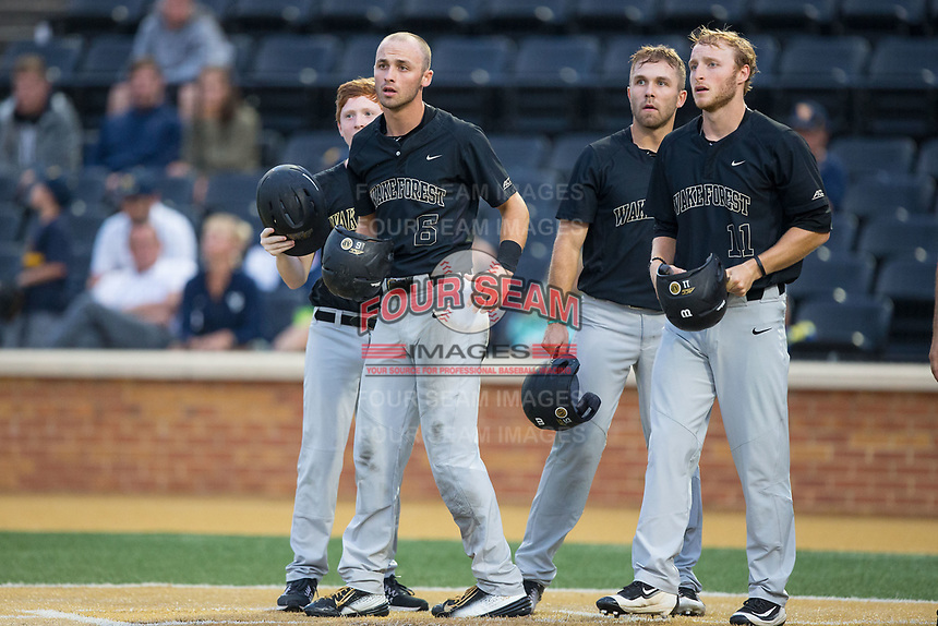 (L-R) Wake Forest Demon Deacons bat boy Elijah Wooten, Jake Mueller (6), Logan Harvey (15), and Jonathan Pryor (11) await the arrival of teammate Stuart Fairchild (not pictured) following his grand slam against the West Virginia Mountaineers in Game Six of the Winston-Salem Regional in the 2017 College World Series at David F. Couch Ballpark on June 4, 2017 in Winston-Salem, North Carolina.  The Demon Deacons defeated the Mountaineers 12-8.  (Brian Westerholt/Four Seam Images)