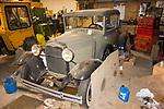 Unrestored 1932 Ford Model A in garage.