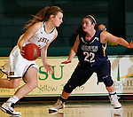 JANUARY 6, 2015 -- Taylor Trohkimoinen #11 of Black Hills State drives toward Alexis Long #22 of South Dakota Mines during their college women's basketball game Tuesday evening at the Donald E. Young Center in Spearfish, S.D.  (Photo by Dick Carlson/Inertia)
