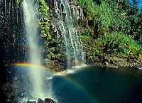 Waterfall in Hana, Maui with a rainbow.