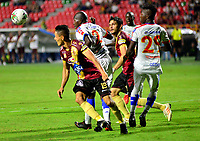 IBAGUE - COLOMBIA, 14-04-2019: Diego Valdés de Deportes Tolima disputa el balón con Anier Figueroa y José Ortiz de Deportivo Pasto, durante partido entre Deportes Tolima y Deportivo Pasto, de la fecha 15 por la Liga Águila I 2019, jugado en el estadio Manuel Murillo Toro de la ciudad de Ibague. / Diego Valdes of Deportes Tolima vies for the ball with Anier Figueroa and Jose Ortiz of Deportivo Pasto, during a match between Deportes Tolima and Deportivo Pasto of the 15th date for the Aguila League I 2019, played at Manuel Murillo Toro stadium in Ibague city. Photo: VizzorImage / Juan Carlos Escobar / Cont.