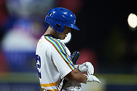 Jayson Gonzalez (32) of the Kannapolis Cannon Ballers adjusts his batting gloves during the game against the Lynchburg Hillcats at Atrium Health Ballpark on August 28, 2021 in Kannapolis, North Carolina. (Brian Westerholt/Four Seam Images)