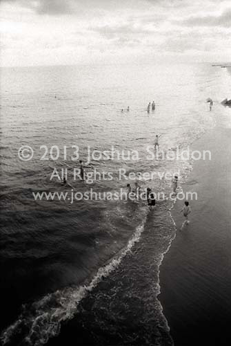 Families playing in the surf at Coney Island<br />