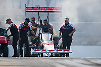 Oct 12, 2019; Concord, NC, USA; Crew members for NHRA top fuel driver Billy Torrence during qualifying for the Carolina Nationals at zMax Dragway. Mandatory Credit: Mark J. Rebilas-USA TODAY Sports