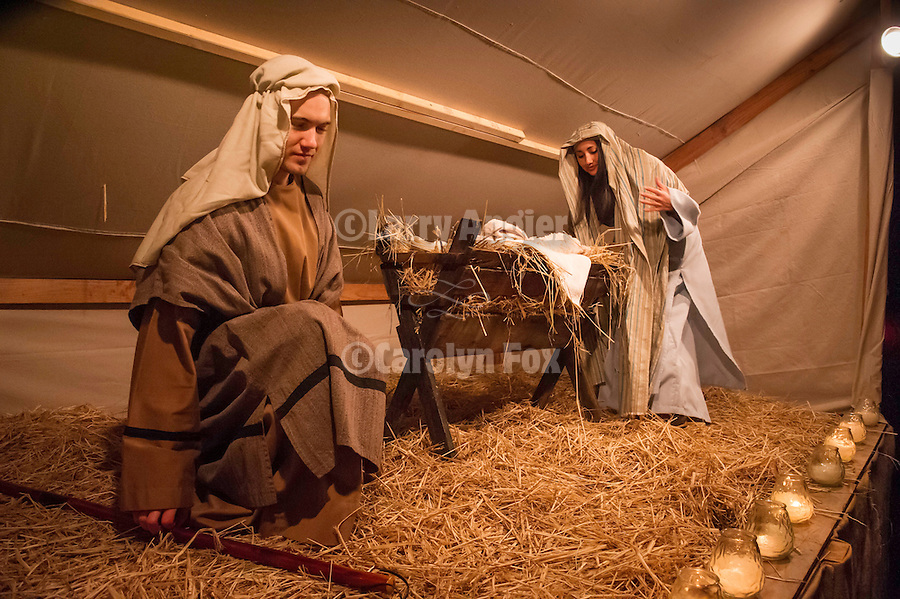 Joseph and Mary at the manger with Baby Jesus. Sutter Creek's annual interfaith Procession of Las Posadas down the side streets and Main Street of Sutter Creek on a winter's evening...Las Posadas symbolizes the trials which Mary and Joseph endured before finding a place to stay where Jesus could be born, based on the passage in the New Testament, the Gospel of Luke, 2:1-9.