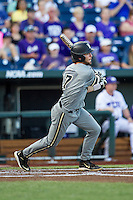 Vanderbilt Commodores shortstop Dansby Swanson (7) follows through on his swing during the NCAA College baseball World Series against the TCU Horned Frogs on June 16, 2015 at TD Ameritrade Park in Omaha, Nebraska. Vanderbilt defeated TCU 1-0. (Andrew Woolley/Four Seam Images)