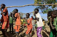 ETHIOPIA Province Benishangul-Gumuz, town Debate, Gumuz village Banush, Gumuz boys play pipe and dance / AETHIOPIEN, Provinz Benishangul-Gumuz, Stadt Debate, Gumuz Dorf Banush, Gumuz floeten Pfeifen und tanzen