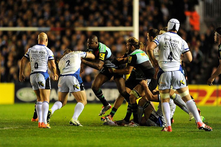 Ugo Monye of Harlequins is stopped by Ross Batty of Bath Rugby