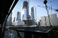 Tenth anniversary of 9/11.  Rebuilding at the World Trade Center site.  The view from under construction 4 WTC, where a crane is being assembled.  L to R: World Financial Center buildings, under-construction 1 WTC, 7 WTC, and postal building.    Photo by Ari Mintz.  8/10/2011.