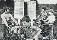 1976 FILE PHOTO - ARCHIVES -<br /> <br /> Even the children need identification. It must be tough being a child in a little town in Quebec and to have what must seem to be a million strangers suddenly show up and demand that you wear a little card around your neck saying who you are and what you're doing there. Well; that's what's happened to Francois; Normand; Raymond and Benuit Gince; who live next door to the equestrian ring in Bromont; Que. But they don't mind.<br /> <br /> PHOTO : Ron BULL - Toronto Star Archives - AQP