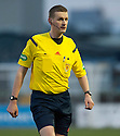 Referee Gavin Ross .