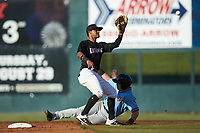 Kannapolis Intimidators shortstop Lenyn Sosa (2) waits for a throw as Matt Whatley (19) of the Hickory Crawdads slides into second base at Kannapolis Intimidators Stadium on May 6, 2019 in Kannapolis, North Carolina. The Crawdads defeated the Intimidators 2-1 in game one of a double-header. (Brian Westerholt/Four Seam Images)