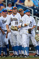 UCLA second baseman Cody Regis (18), outfielder Eric Filia (4) and pitcher Grant Watson (12) before Game 12 of the 2013 Men's College World Series against the North Carolina Tar Heels on June 21, 2013 at TD Ameritrade Park in Omaha, Nebraska. The Bruins defeated the Tar Heels 4-1, to reach the CWS Final and eliminate North Carolina from the tournament. (Andrew Woolley/Four Seam Images)