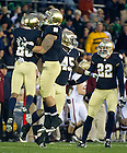 November 19, 2011; Notre Dame Fighting Irish safety Jamoris Slaughter (26) celebrates a tackle with inside linebacker Manti Te'o during the second quarter against the Boston College Eagles. Photo by Barbara Johnston/University of Notre Dame.