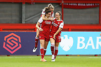 Jennifer Beattie (Left) of Arsenal scores the third goal for her team and celebrates during Brighton & Hove Albion Women vs Arsenal Women, Barclays FA Women's Super League Football at Broadfield Stadium on 11th October 2020
