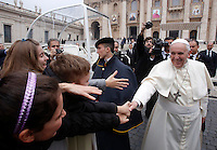 Papa Francesco saluta un gruppo di bambini al termine dell'udienza generale del mercoledi' in Piazza San Pietro, Citta' del Vaticano, 26 novembre 2014.<br /> Pope Francis greets some children at the end of his weekly general audience in St. Peter's Square at the Vatican, 26 November 2014.<br /> UPDATE IMAGES PRESS/Riccardo De Luca<br /> <br /> STRICTLY ONLY FOR EDITORIAL USE