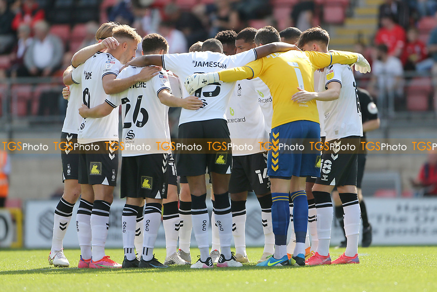 Oldham players huddle during Leyton Orient vs Oldham Athletic, Sky Bet EFL League 2 Football at The Breyer Group Stadium on 11th September 2021