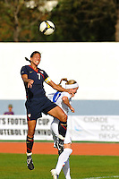 USA captain, Shannon Boxx, wins a header vs. Iceland's Dora Maria Larusdottir.  The USWNT defeated Iceland (2-0) at Vila Real Sto. Antonio in their opener of the 2010 Algarve Cup on February 24, 2010.