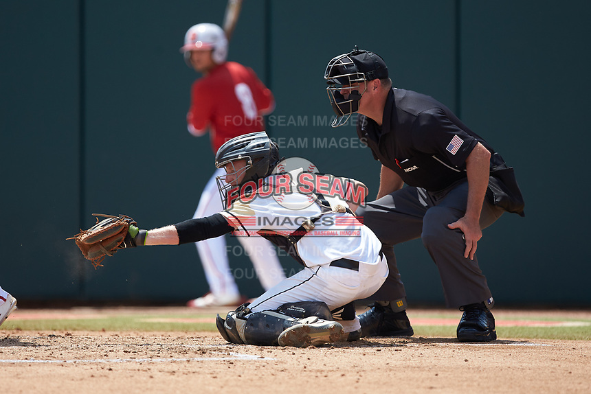 Army Black Knights catcher Jon Rosoff (7) frames a pitch as home plate umpire Mike Jarboe looks on during the game against the North Carolina State Wolfpack at Doak Field at Dail Park on June 3, 2018 in Raleigh, North Carolina. The Wolfpack defeated the Black Knights 11-1. (Brian Westerholt/Four Seam Images)