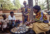 Niamey, Niger.  Street Vendor Making Pancakes for Breakfast.