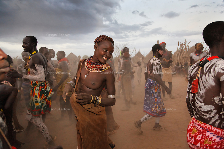 This is just an evening dance in Duss village.  If there will be a full moon, they tend to go down to the river, bathe, apply paint and the dance all night.  The harvest is complete, there is enough food and I am the only Anglo for about 200 miles privileged to witness this REAL event in this part of Ethiopia.