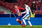 Kevin Gameiro (L) of Atletico de Madrid battles for the ball with Ezequiel Matias Munoz of CD Leganes during the La Liga 2017-18 match between Atletico de Madrid and CD Leganes at Wanda Metropolitano on February 28 2018 in Madrid, Spain. Photo by Diego Souto / Power Sport Images