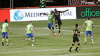 COLUMBUS, OH - DECEMBER 12: Yeimar Gomez Andrade #28 of the Seattle Sounders FC and Jonathan Mensah #4 of the Columbus Crew challenge for a header during a game between Seattle Sounders FC and Columbus Crew at MAPFRE Stadium on December 12, 2020 in Columbus, Ohio.