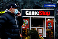 NEW YORK, NEW YORK - FEBRUARY 25: A man talks by his phone in front of GameStop at 6th Avenue on February 25, 2021 in New York. GameStop Corp. doubled its shares and and jumped another 19% today and the betting are that GameStop shares would spike to $800 on Friday. (Photo by John Smith/VIEWpress via Getty Images)