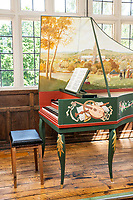 BNPS.co.uk (01202 558833)<br /> Pic: MaxWillcock/BNPS<br /> <br /> A one a kind harpsichord on display in the Ceramics Gallery at The Salisbury Museum has undergone a restoration after it was repainted by Diana de Vere Cole. She painted flowers and ribbons along the sides, adding to the artwork she had previously painted.<br /> <br /> This harpsichord was made by the late James Mogford of St Ann Street in Salisbury in 1984, and the painting of Salisbury Cathedral was then added by Diana de Vere Cole.<br /> <br /> The painting on the inside of the lid depicts a scene of people playing music in a field with Salisbury Cathedral in the background.