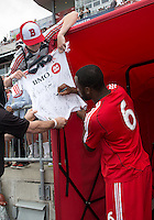 29 June 2013: Toronto FC defender Gale Agbossoumonde #6 signs an autograph after warm-ups during an MLS game between Real Salt Lake and Toronto FC at BMO Field in Toronto, Ontario Canada.<br /> Real Salt Lake won 1-0.