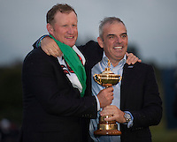 28.09.2014. Gleneagles, Auchterarder, Perthshire, Scotland. The Ryder Cup, final day.  Paul McGinley European Team Captain and Jamie Donaldson (EUR), who won the winning point, celebrate with the Ryder Cup after Sunday Singles.  Europe won sixteen and a half points to eleven and a half points.